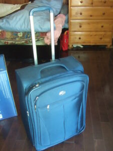 new condition blue american tourist extensible rolling luggage,6