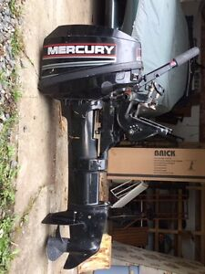 8 hp Mercury Outboard Motor, Mounting Bracket, Tank and Hose