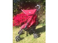 Red McLaren Techno xt pushchair with wheeled travel case, rain cover, seat cover and umbrella £70