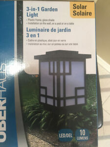 Solar lamp- glass shade- brand new! Table or fence use