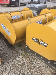 NEW SNOW PLOWS AND PUSHERS AVAILABLE