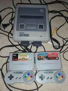 Super Nintendo console SNES with 2 controllers and 2 games. Bulli Wollongong Area Preview