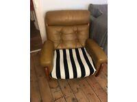 Vintage / Retro tan leather chair on wheels