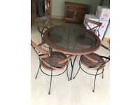 CIRCULAR TABLE AND 4 CHAIRS FROM THE PIER