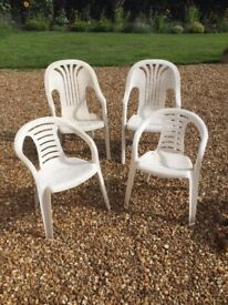 White plastic garden outdoor chairs, used, near Easingwold