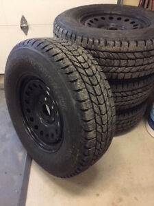 One set of Firestone Winterforce Studded Tires
