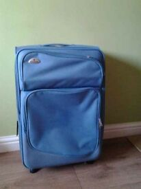 Blue samsonite suitcase on wheels