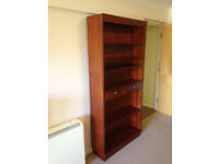 Dark mahogany veneer wood tall bookcase with central drawers