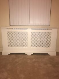 Six bespoke made to measure solid wood white radiator covers for sale.