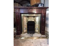 Cast Iron Victorian 'style' fireplace with brass/tile inlay.