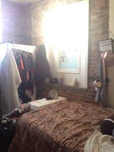 Furnished room in sunny, exposed brick loft for April 1st!