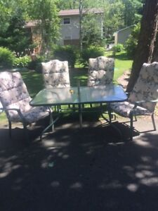 Patio set with glass top table and 4 chairs
