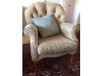 Two seater embossed gold couch and two chairs