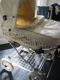 TWO IN ONE PRAM IN LEATHER AND WICKER BODY IN GOOD USED CONDITION
