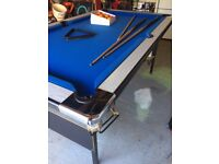 Pool Table in fair condition, includes cues & balls and can be folded away