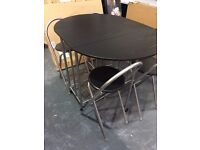 NEW FOLD AWAY BLACK TABLE AND 4 CHAIRS
