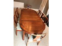 Solid rosewood dining room table and 8 chairs