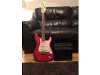 Red Strat Electric Guitar with Amp,case.tuner, as new