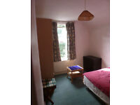 single room with double storage bed near stations