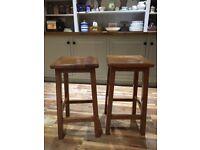 A pair of John Lewis Oak Breakfast bar stools