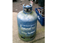 blue calor/ butane 13 kg gas cylinder, with regulator and some gas, about 25% left