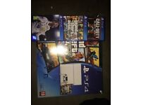 White playstation 4 with 3 games