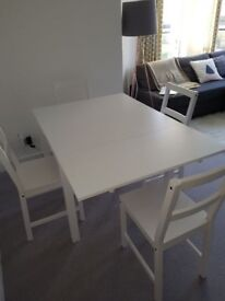 White extendable scandi style table with four chairs great condition