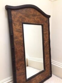 Mirror with wooden pictorial surround