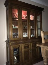 Wooden display cabinet/sideboard. Cupboard below, display upper, glass panels with lights inside.