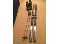 Women's ski boots - Salomon size 7.5, Dynastar skis and poles.
