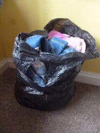 Black bin bag of girls clothes 7-8 years