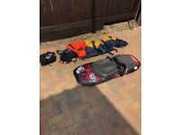 Jobe Shock knee board with 2 adult, 2 children, 1 toddler Life Jackets.