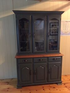 Dining room hutch with table and chairs