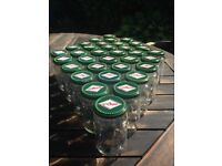 Glass jars with lids cleaned and ready for use with jams, jellies, pickles, chutneys or crafts