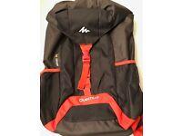 Decathlon Quechua Arpenza 40 litre lightweight backpack in black and orange