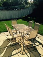 Patio table (glass) with 6 chairs