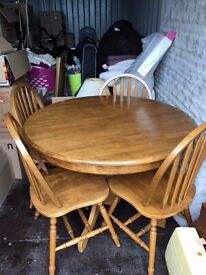 extending solid wood dinning round table and 4 chairs,with claw foot.