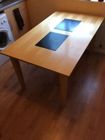 Wood kitchen table with heat inserts. 4x brown leather seats.