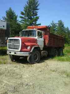 Ford tandem dump truck and float