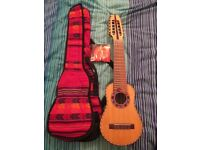 Charango (From Bolivia). This is a handcrafted instrument with a beautiful sound