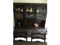 Solid Dark Oak dining table, 6 chairs, display cabinet with drawers, cupboards by Stanley Wood