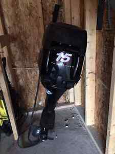 Mercury 15 hp short shaft 4 stroke outboard with electric start.