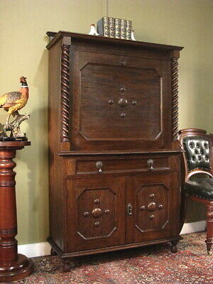 VINTAGE JACOBEAN STYLE OAK WRITING DESK OR DRINKS CABINET WITH STORAGE  c1930s