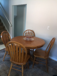 Wood table with four chairs and insert