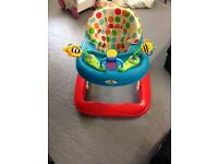 Babywalker, bright ans cheerful which adjusts easily to three different heights.