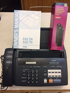 Phone/Fax combo with spare fax cartridge