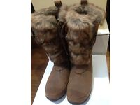 North Face brown furry thigh length boots