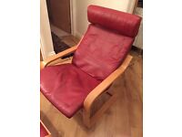 Red leather Ikea Poang armchairs and foot stool