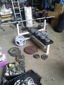 Cast iron weights, bar and bench