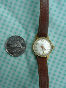 vintage lady mechanic winding wrist watch
